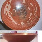Brown Ceramic Bowl with Fish Design
