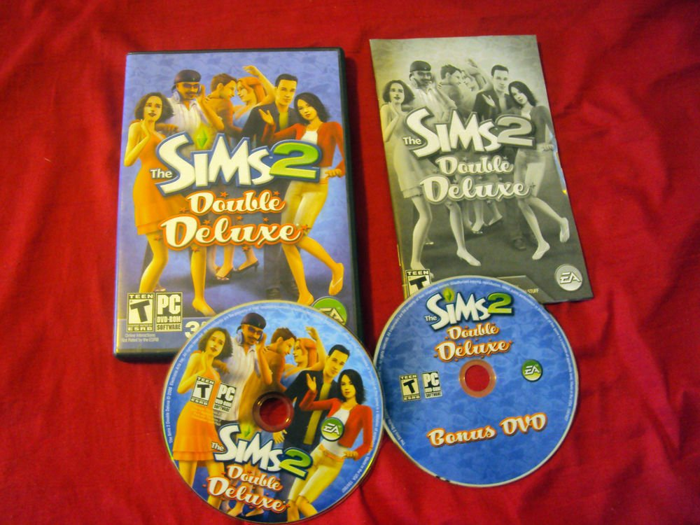 SIMS 2 DOUBE DELUXE PC DISCS MANUAL ART & CASE NEAR MINT TO VG HAS CODE