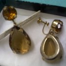 Antique screwback earrings in amber topaz and smoky topaz mounted in gold metal