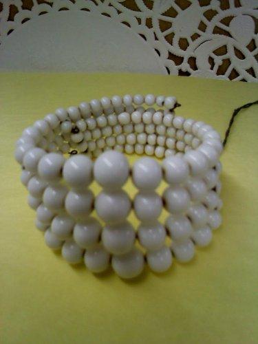 Vintage milk glass 4 strand bracelet strung on memory wire