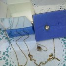 "Avon rhinestone ""Bezel set CZ - two piece set goldtone"" new in box necklace and earrings"