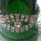 Two strand rhinestone bracelet with 3 large center rhinestones