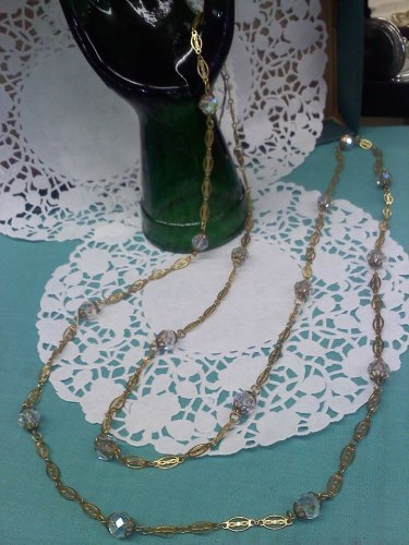 54 inch vintage Aurora Borealis crystal necklace on goldtone filigree chain