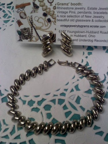 "Avon ""San Marco"" silvertone pierced earrings and bracelet"