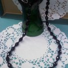 Faceted jet black bead 24 inch long vintage necklace
