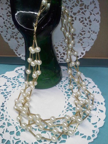 Avon four strand goldtone and faux pearl necklace
