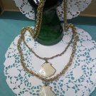 Whiting & Davis twisted link two chain gold tone vintage necklace with real shell pendants