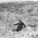 New 5x7 World War I Photo: German Soldier with Grenade in Shell Hole