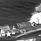 New 5x7 World War II Photo: Aerial View of SB2C Aircraft with USS YORKTOWN Below