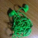 green ear bud headphones