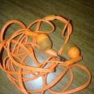 orange ear bud headphones