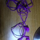 purple ear bud headphones