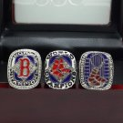 A set Boston Red Sox 2004 2007 2013 world series championship rings size 11 US with wooden case