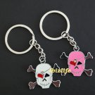 Metal keychain - a pair of keychains with 2 SKULL shapes  (kc15)