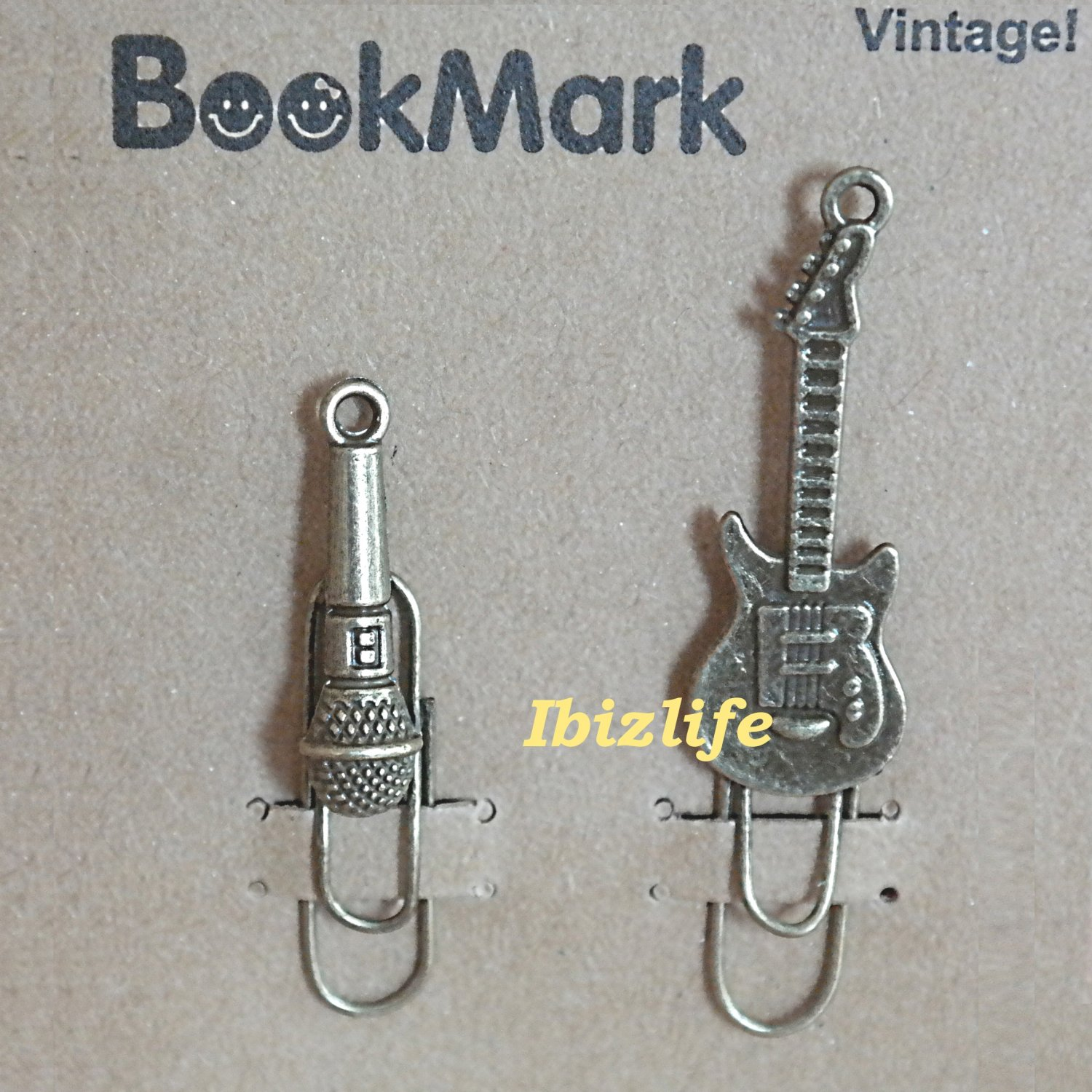 A pair of metal clip with brown color bookmark:microphone and guitar (bm05)