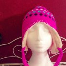 Girl's knitted winter hat by Solid Wing, color: Dark Pink, braided ties with tassel, pompom