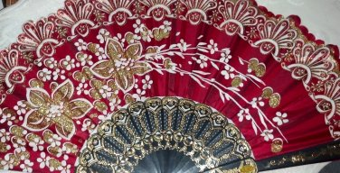 """Folding Fan, Ruby red silk with gold and white floral spray by """"Silk Breeze"""""""