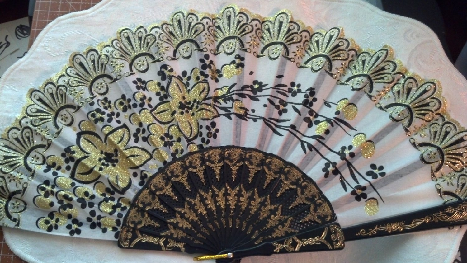 "Folding Fan, light gray silk with gold glitter and black floral bouquet by ""Silk Breeze"""