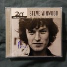 "STEVE WINWOOD Signed Autographed  ""THE BEST OF"" CD  w/COA"