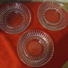Trio of vintage pressed glass pillar candleholders/dishes