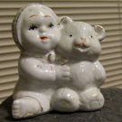 Vintage ceramic baby holding large teddy bear from GOT