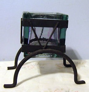 Heavy square glass candle holder on wrought black metal frame