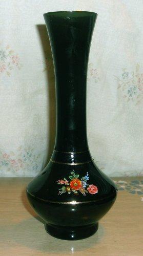 Dark dark green vase (a hair this side of black), gold trim, bouquet on front