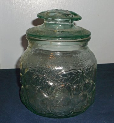 Pale green glass canister with embossed fruit pattern