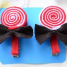 red and white lollipop hair clips