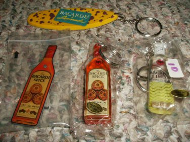 FOUR BACARDI RUM KEYCHAINS AND PINS