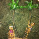 RESIN CANDLE HOLDER WITH 2 MONKEYS PALM TREE