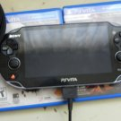 Black Sony PS Vita 8gb (Wi-Fi) w/ 5 games