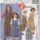 McCall's  3413 Girls' Jumper and Contrasting Apron Sewing Pattern Size 10, 12, 14 uncut