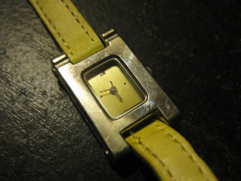 """Ladies """"H"""" Shaped yellow band Wrist watch"""