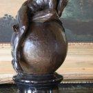 Nude Male on a Globe Bronze Sculpture