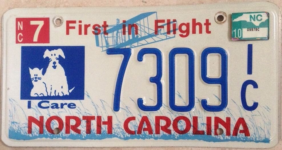 Rare North Carolina I Care 4 Animals license plate dog cat Friendly Lover  Pet