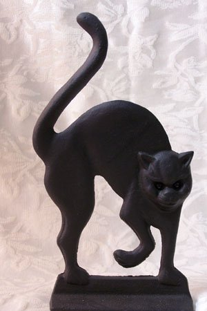 Cast Iron Black Cat Doorstop with Glass Eyes