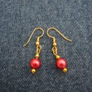 Reddish pink bead earrings
