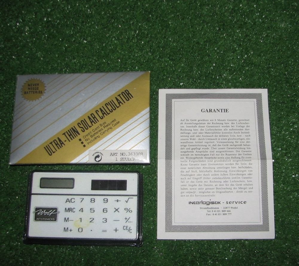 Vintage Calculator Advertising WOLF INTERSNACK Solar Power Plastic case Warranty