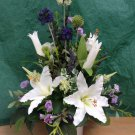 Tall artificial mixed flower and foliage table posy.