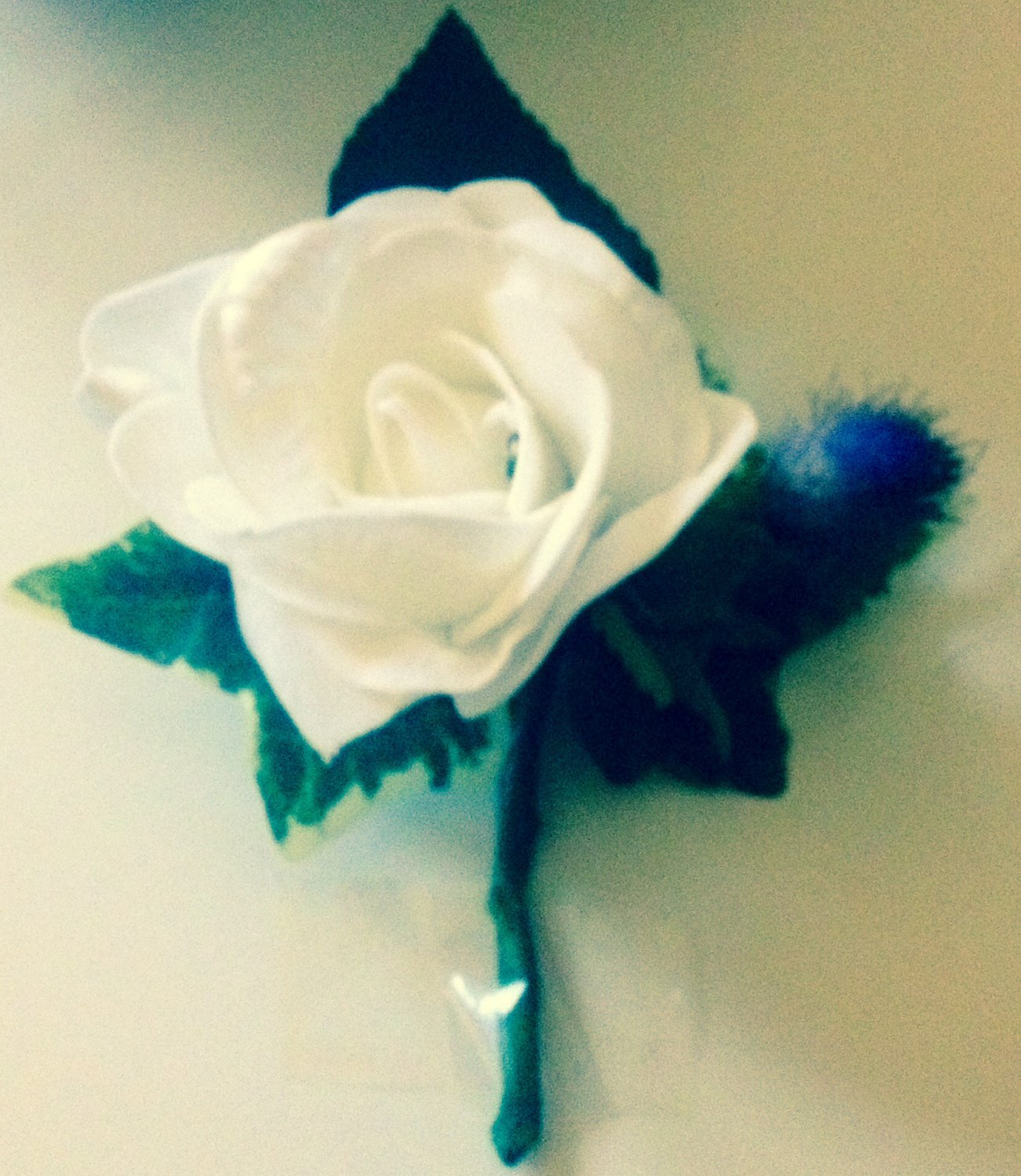 Artificial gents buttonhole Rose and Thistle.