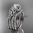 14kt white gold diamond celtic trinity knot engagement ring with a Moissanite center stone CT7155S