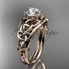 14kt rose gold celtic trinity knot engagement ring with a Moissanite center stone CT765