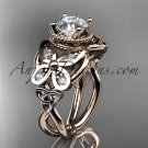14kt rose gold celtic trinity knot butterfly engagement ring with a Moissanite center stone CT7136