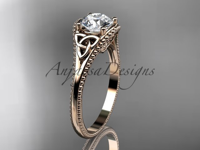 14kt rose gold celtic trinity knot engagement ring with a Moissanite center stone CT7375