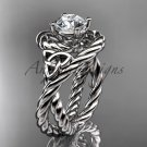 14kt white gold celtic trinity twisted rope wedding ring with a  Moissanite center stone RPCT9320