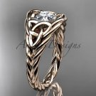 14kt rose gold celtic trinity rope wedding ring with a Moissanite center stone RPCT964