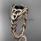14kt rose gold celtic trinity rope wedding ring with a Black Diamond center stone RPCT964