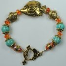 handcrafted Turquoise Howlite Bracelet with Orange Crystal and Gold Plated Fishes
