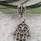 Silver Hansa Hand Charm on a Dark Green Ribbon Necklace
